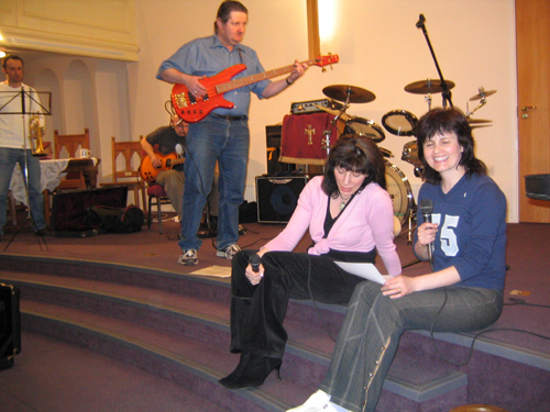 The band, some of whom are seated
